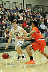 17 November 2015:  Joel Pennington(12) brings the ball up to the 3 point line and is joined by a defender during an NCAA men's division 3 CCIW basketball game between the Greenville College Panthers and the Illinois Wesleyan Titans in Shirk Center, Bloomington IL