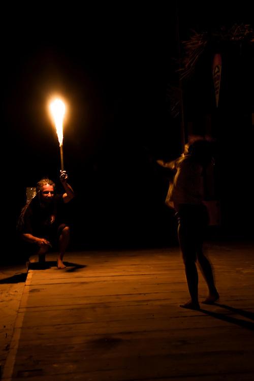 Fire dancer performs with daughter at Bananarama Resort in Roatan, Honduras. Copyright 2010 Reid McNally.