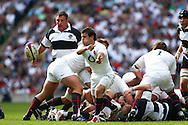 Twickenham - Sunday 30 May, 2010: England scrum half Danny Care passes the ball out of a ruck during the match between England and the Barbarians at Twickenham. (Pic by Andrew Tobin/Focus Images)