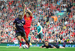 02.09.2012, Anfield, Liverpool, ENG, Premier League, FC Liverpool vs FC Arsenal, 2. Runde, im Bild Liverpool's Luis Alberto Suarez Diaz appeals for a penalty against Arsenal during the English Premier League 2nd round match between Liverpool FC and Arsenal FC at Anfield, Liverpool, Great Britain on 2012/09/02. EXPA Pictures © 2012, PhotoCredit: EXPA/ Propagandaphoto/ David Rawcliff..***** ATTENTION - OUT OF ENG, GBR, UK *****