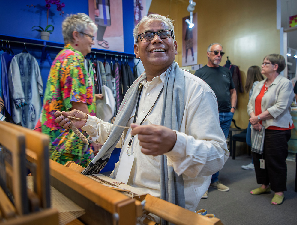 em071317k/jnorth/Dahyalal Atmaram Kudecha, from India, takes a break from weaving to talk with people at Singular Couture in Santa Fe Thursday July 13, 2017. He is one of several artist that are here for the International Folk Art Market and were demonstrating their crafts at businesses around town.  (Eddie Moore/Albuquerque Journal)