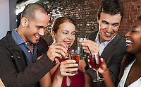 Two couples toasting standing in bar