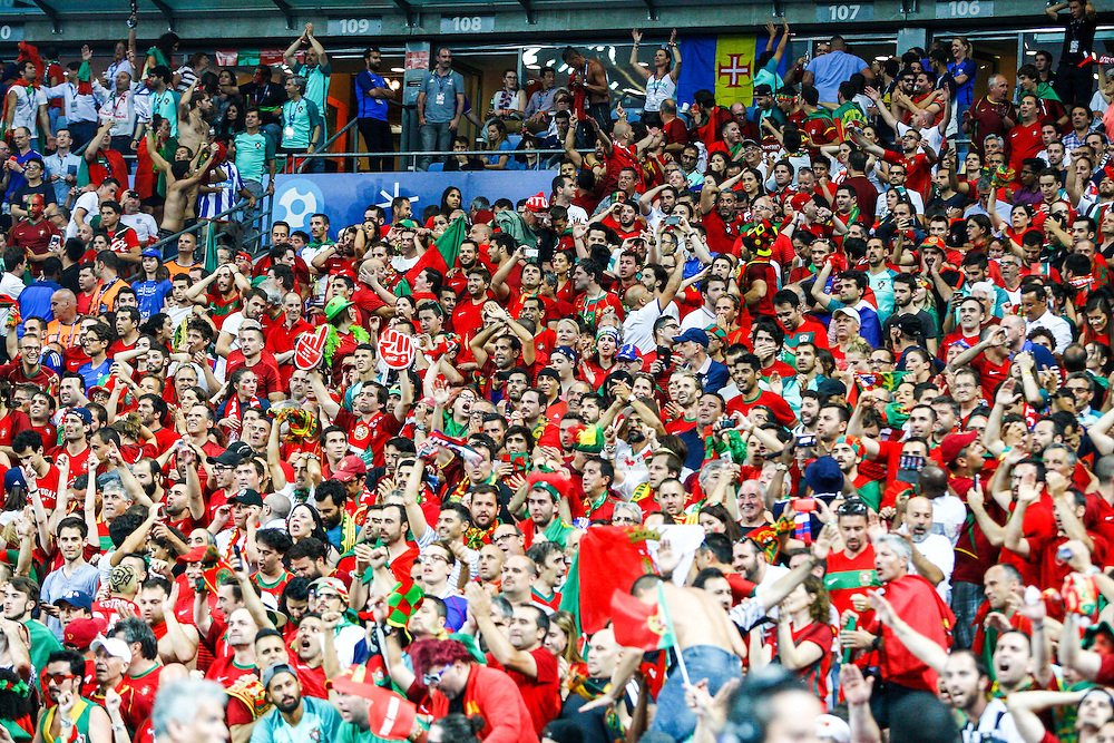 Portuguese supporters during the match that opposed Portugal and France. Portugal won the Euro Cup beating in the final home team France at Saint Denis stadium in Paris, after winning on extra-time by 1-0.