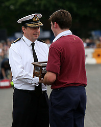Fareham,Hampshire  Saturday 4 June 2016 The most spectacular event took place at HMS Collingwood, Fareham, Hampshire when the establishment opened it gates for the annual Open Day, sponsored by 8 Wealth Management featuring the Royal Navy and Royal Marines Charity (RNRMC) Field Gun Competition.<br /> The Field Gun competition featured crews from across the UK and as far afield as Gibraltar competing for the coveted Brickwoods Trophy.&nbsp;The competition was fast and furious and required 18-man teams to run, dismantle, reassemble and fire the gun in the shortest possible time, traditionally in heats of 6 crews at a time.Strength, stamina, and team work are essential in this challenge. <br /> There where  other  attractions, entertainment and displays designed to capture the imagination of everyone from 8 to 80. Attractions included the Tigers Motorcycle Display Team, plus extensive recruitment zone with interactive activities and much more.&copy;UKNIP