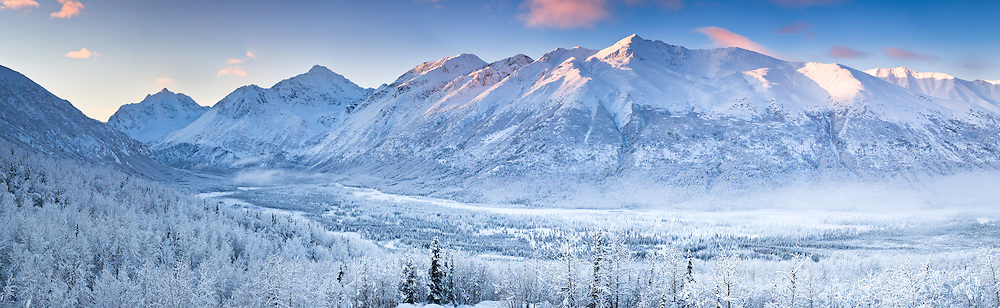 Composite panorama of Polar Bear and Eagle Peaks and Hurdygurdy Mountain overlooking Eagle River Valley in Chugach State Park in Southcentral Alaska. Winter.