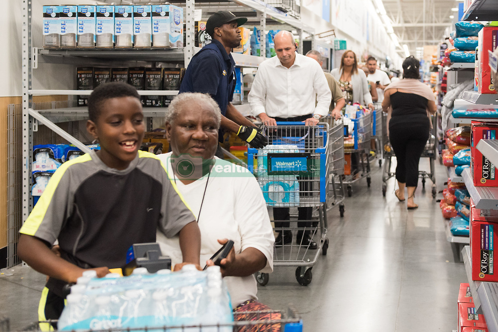 September 5, 2017 - Fort Lauderdale, Florida, U.S - Residents of south Florida line up to buy water at Walmart in Fort Lauderdale in preperation for hurricane Irma. Florida Governor, Rick Scott, declared a state of emergency for all counties in Florida on Monday, in enticipation of possible impact of category five Hurricane Irma later this week. (Credit Image: © Orit Ben-Ezzer via ZUMA Wire)