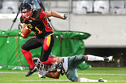08.07.2011, Tivoli Stadion, Innsbruck, AUT, American Football WM 2011, Group A, Germany (GER) vs Mexico (MEX), im Bild Julian Dohrendorf (Germany, #81, WR) gets stopped by Silva Roberto javier (Mexico, #13, CB)  // during the American Football World Championship 2011 Group A game, Germany vs Mexico, at Tivoli Stadion, Innsbruck, 2011-07-08, EXPA Pictures © 2011, PhotoCredit: EXPA/ T. Haumer