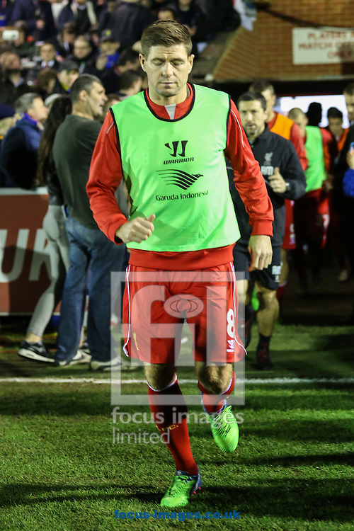 Steven Gerrard of Liverpool enters the AFC Wimbledon pitch to warm up ahead of the FA Cup match at the Cherry Red Records Stadium, Kingston<br /> Picture by David Horn/Focus Images Ltd +44 7545 970036<br /> 05/01/2015