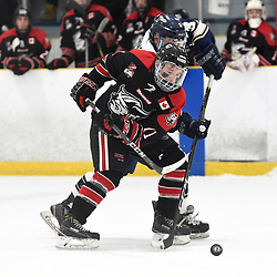TORONTO, ON  - APR 10,  2018: Ontario Junior Hockey League, South West Conference Championship Series. Game seven of the best of seven series between Georgetown Raiders and the Toronto Patriots. Bailey Molella #11 of the Georgetown Raiders battles for the puck with Nicholas Favaro #3 of the Toronto Patriots during the second period.<br /> (Photo by Andy Corneau / OJHL Images)