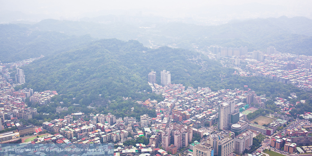 The city of Taipei as seen from the observation deck of Taipei 101. The haze is typical of the ever present polution.