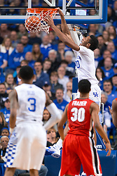 Kentucky forward Marcus Lee dunks after a lob from guard Tyler Ulis in the first half.<br /> <br /> The University of Kentucky hosted the University of Georgia, Tuesday, Feb. 09, 2016 at Rupp Arena in Lexington .