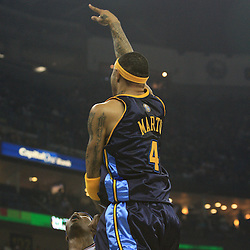 28 January 2009: Denver Nuggets forward Kenyon Martin (4) shoots over New Orleans Hornets forward James Posey (41) during a 94-81 win by the New Orleans Hornets over the Denver Nuggets at the New Orleans Arena in New Orleans, LA. The Hornets wore special throwback uniforms of the former ABA franchise the New Orleans Buccaneers for the game as they honored the Bucs franchise as a part of the NBA's Hardwood Classics series. .