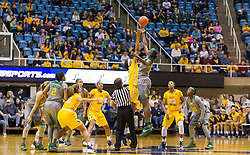 Jan 30, 2016; Morgantown, WV, USA; West Virginia Mountaineers center Lanay Montgomery (15) and Baylor Bears forward/center Beatrice Mompremier (32) jump for the tip ball to begin the game at WVU Coliseum. Mandatory Credit: Ben Queen-USA TODAY Sports