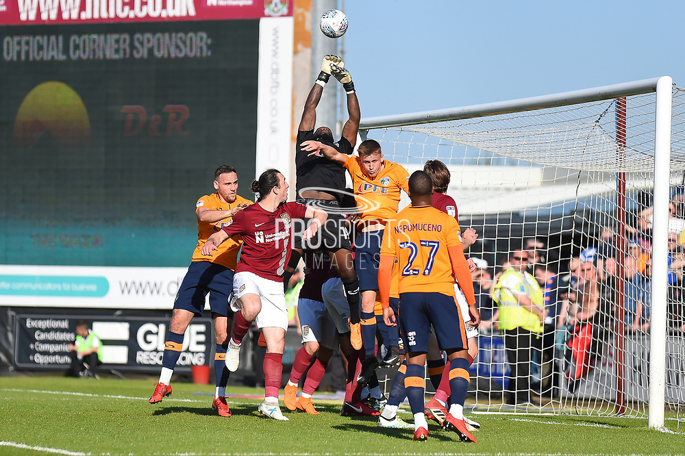 Oldham Athletic goalkeeper Johny Placide (19) makes an important save  during the EFL Sky Bet League 1 match between Northampton Town and Oldham Athletic at Sixfields Stadium, Northampton, England on 5 May 2018. Picture by Dennis Goodwin.
