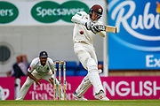 **Caption Correction** Jamie Smith of Surrey of Surrey hits the ball to the boundary for four runs during the Specsavers County Champ Div 1 match between Surrey County Cricket Club and Warwickshire County Cricket Club at the Kia Oval, Kennington, United Kingdom on 23 June 2019.