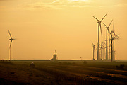 Traditional windmill Goliath alongside its big brothers in windmill park Westereems in the Eemshaven // Windmolen De Goliath en zijn grote broeders van het Windmolenpark Westereems in de Eemshaven.