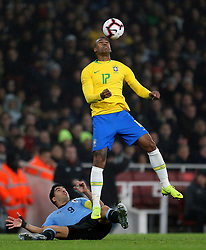 Uruguay's Luis Suarez (left) and Brazil's Walace (right) battle for the ball during the International Friendly match at the Emirates Stadium, London.