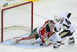 Mar 17; Newark, NJ, USA; New Jersey Devils goalie Martin Brodeur (30) stops Pittsburgh Penguins left wing Chris Kunitz (14) on a penalty shot during the first period at the Prudential Center.