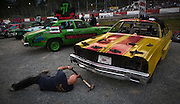 A driver does some last minute repairs on his car prior to qualifications at the Agassiz Speedwat in Agassiz, BC. (2012)