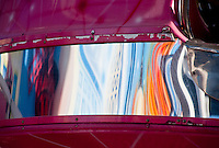 Chartres, France. Distorted reflection on a ferris wheel gondola.