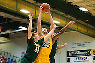 Vermont's Drew Urquhart (25) leaps over Lyndon's Robbie Roulle (33) to grab the rebound during the men's basketball game between the Lyndon State Hornets and the Vermont Catamounts at Patrick Gym on Saturday afternoon November 19, 2016 in Burlington (BRIAN JENKINS/for the FREE PRESS)