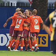 Matt McKay is mobbed by team mates after scoring Brisbane's winner during the Central Coast Mariners V Brisbane Roar A-League match at Bluetongue Stadium, Gosford, Australia, 19 December 2009. Photo Tim Clayton