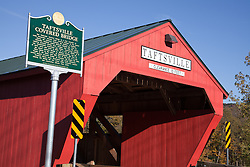 Windsor County (Woodstock), Vermont: The Taftsville Bridge is a two span 189 foot long Multiple Kingpost Truss with an arch. Spans are 89 and 100 feet. It carries River Road the over Ottaquechee River in Taftsville Vermont. This bridge was built in 1836 and is the third oldest covered bridge in Vermont and the second longest.