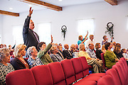 The congregation worships during the first service with chairs instead of pews at the Windham Church of the Nazarene in Windham, Maine on Sunday, September 22, 2013.<br /> The church recently made the transition from fixed wooden pews to new moveable padded chairs.<br /> CREDIT: Craig Dilger for The Wall Street Journal<br /> <br /> PEWWARS