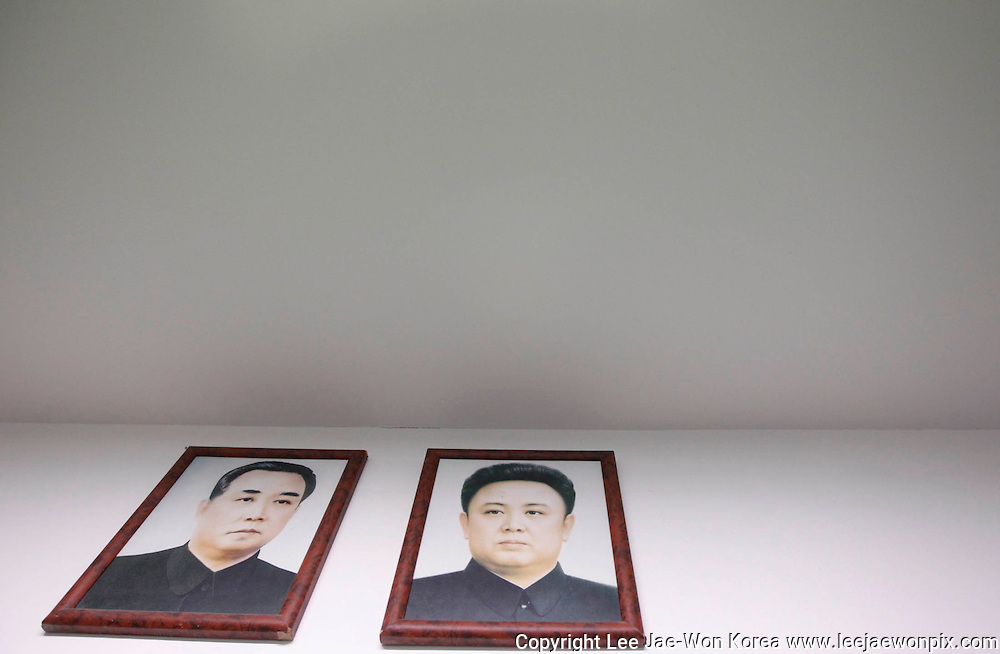 Portraits of North Korean founder Kim Il-sung (L) and his son and late leader Kim Jong-il are hung at a pavilion, just south of the border between the two Koreas, in Paju, north of Seoul. Photo by Lee Jae-Won (SOUTH KOREA) www.leejaewonpix.com/