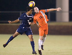 Virginia Cavaliers MF Will Hall (16) and Mount Saint Mary's Mountaineers MF Alex Kem (7) fight for a header.  The #4 ranked Virginia Cavaliers men's soccer team defeated the Mount Saint Mary's Mountaineers 3-0 at Klockner Stadium in Charlottesville, VA on September 25, 2007.