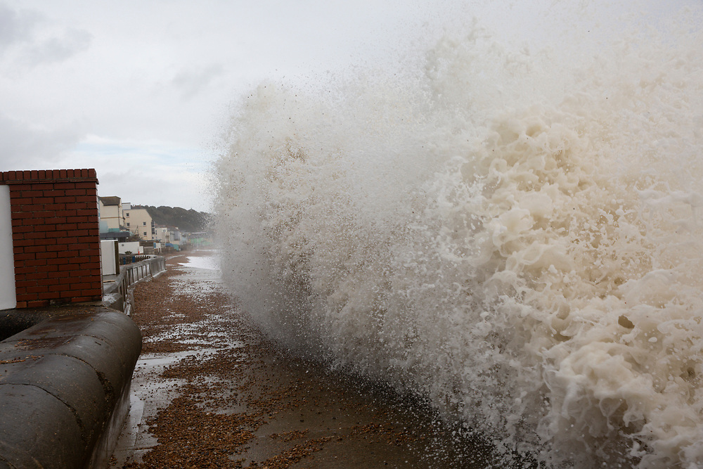 Waves cresting over the pedestrian walkway in Sandgate near Folkestone, Kent on the south coast of England,  Monday February 10, 2020, as Storm Ciara continues to sweep over the United Kingdom. Amber weather warnings were put into place by the MET office as gusts of up to 90mph and heavy rain swept across the UK. An amber warning from the MET office expects a powerful storm that will disrupt air, rail and sea links travel, cancel sports events, cut electrical power and damage property.  (photo by Andrew Aitchison / In pictures via Getty Images)