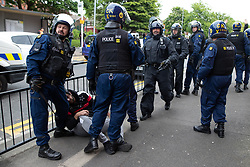 © Licensed to London News Pictures . 18/05/2019. Oldham, UK. Riot police detain a man , who is subsequently taken in to the back of a police van . Former EDL leader Stephen Yaxley-Lennon (aka Tommy Robinson ) continues his campaign for a seat in the European Parliament representing the North West of England , by visiting Oldham . Photo credit: Joel Goodman/LNP