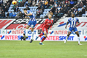 Wigan Athletic Defender, Craig Morgan clears the ball upfield during the Sky Bet League 1 match between Wigan Athletic and Oldham Athletic at the DW Stadium, Wigan, England on 13 February 2016. Photo by Mark Pollitt.