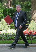 © Licensed to London News Pictures. 10/06/2014. Westminster, UK  Patrick McLoughlin, Conservative MP, Secretary of State for Transport arrives at Cabinet 10th June 2014. Photo credit : Stephen Simpson/LNP