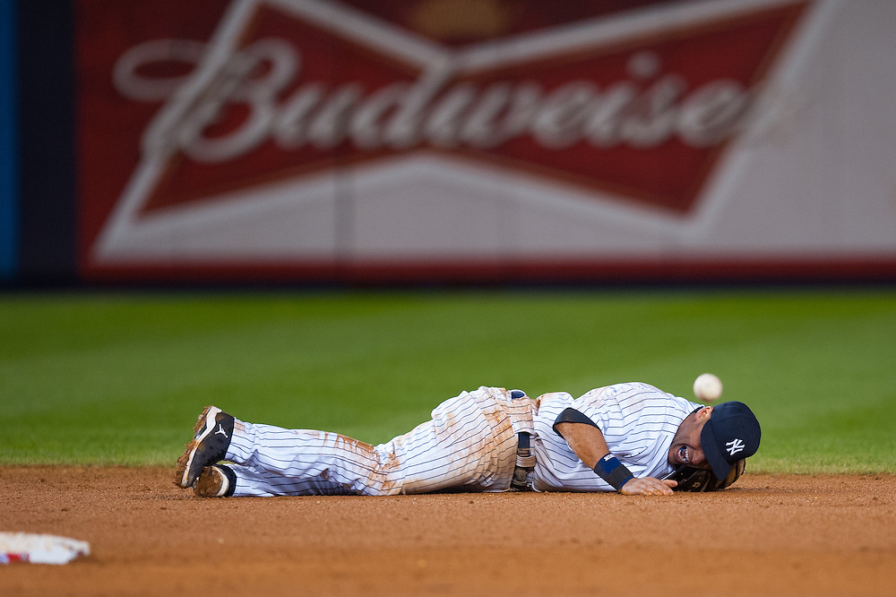 NEW YORK, NY - OCTOBER 13:  Derek Jeter #2 of the New York Yankees lays on the ground after fracturing his ankle in the top of the 12th inning against the Detroit Tigers during Game One of the American League Championship Series at Yankee Stadium on October 13, 2012 in the Bronx borough of New York City, New York.  (Photo by Rob Tringali) *** Local Caption *** Derek Jeter