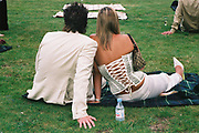 Couple relaxing on a rug on the lawn with Evian, Posh at Addington Palace, UK, August, 2004