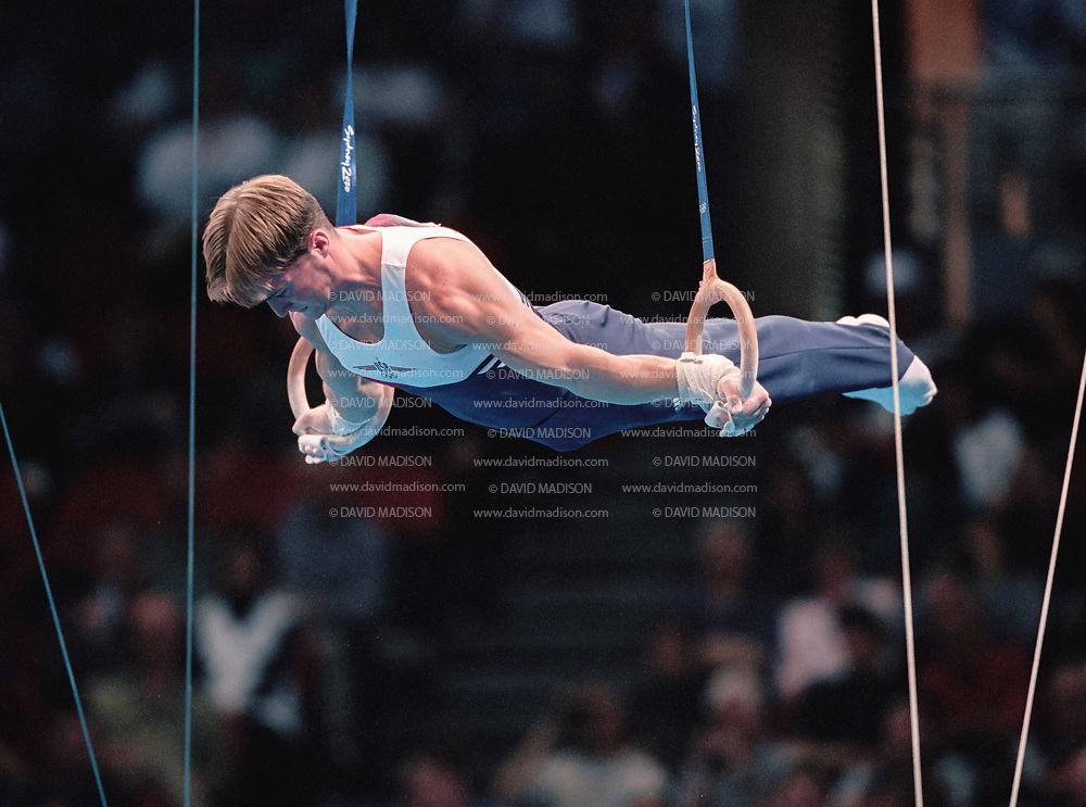 SYDNEY - SEPTEMBER 1:  Morgan Hamm of the United States competes on the still rings during the Men's Gymnastics events of the Olympic Games during September 2000 in Sydney, Australia.  (Photo by David Madison/Getty Images)
