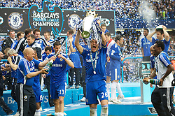 LONDON, ENGLAND - Sunday, May 9, 2010: Chelsea's Captain John Terry shows his delight at winning the 2009/10 Premier League Trophy during the final Premiership match of the season at Stamford Bridge. (Pic by Gareth Davies/Propaganda)