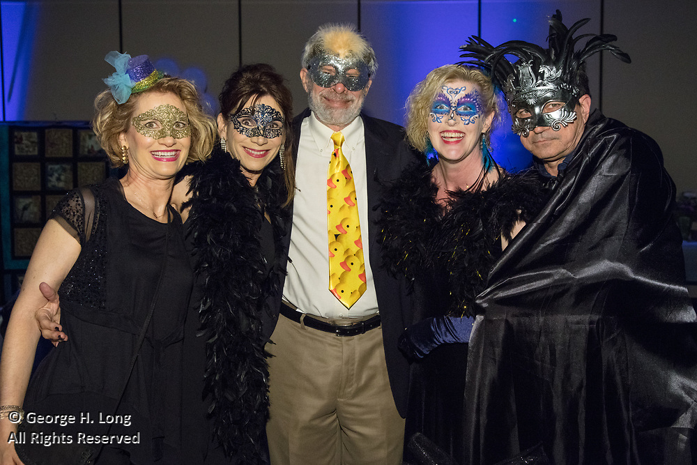 "Mary Jane Hornaday, Keith Petersen, Elizabeth and Jeff Bell; The Women's Center for Healing and Transformation ""An Evening of Masquerade"" fifth annual fundraising gala at the Castine Center in Mandeville, Louisiana on March 31, 2017"