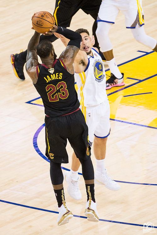 Golden State Warriors guard Klay Thompson (11) defends Cleveland Cavaliers forward LeBron James (23) during Game 1 of the NBA Finals at Oracle Arena in Oakland, Calif., on May 31, 2018. (Stan Olszewski/Special to S.F. Examiner)