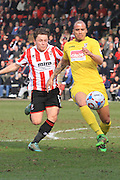 Jack Munns and Jake Caprice during the Vanarama National League match between Cheltenham Town and Woking at Whaddon Road, Cheltenham, England on 12 March 2016. Photo by Antony Thompson.