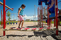 Abby Godwin, 5, walks across a small bridge on the playground equipment Tuesday at Syringa Park in Post Falls.  Syringa Park is one of two parks the city will showcase Saturday during Post Falls Parks Day.