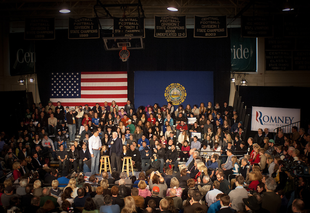 Presidential hopeful Mitt Romney, coming off an 8 vote Iowa win, is endorsed by Arizona Senator John McCain at a town hall event at Manchester Central High School in Manchester, NH.