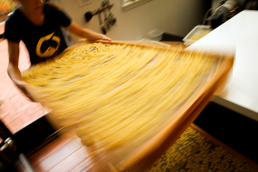 Leah Ferrazzani stacks a drying rack of Conchiglie pasta shells as she manufactures Semolina Artisanal Conchiglie Pasta in her home kitchen on Friday, December 5, 2014 in Los Angeles, Calif.<br /> CREDIT: Patrick T. Fallon for The Wall Street Journal<br /> Assignment ID: 35818 Slug: FOODSTARTUPS<br /> Story Summary:<br /> There have been a growing number of food-industry startups in recent years in California as demand grows for locally-sourced food. But scaling up a small food business can be challenging in the face of complex regulations and big food retailers&rsquo; production standards. A first-of-its-kind &quot;food incubator&quot; where small food companies will soon be working alongside each other as they try to grow together. The &ldquo;incubator&rdquo; space, L.A. Prep, will allow small-scale producers to share administration and overhead costs.
