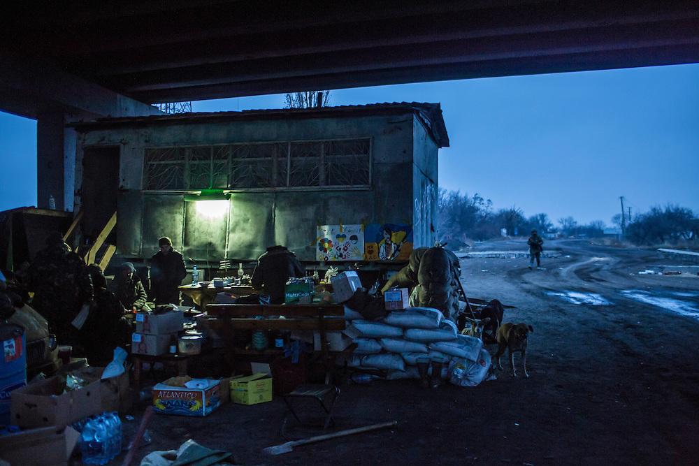 PERVOMAISKE, UKRAINE - NOVEMBER 19, 2014: Members of the Dnipro-1 brigade, a pro-Ukraine militia, at their base under a bridge in Pervomaiske, Ukraine. CREDIT: Brendan Hoffman for The New York Times