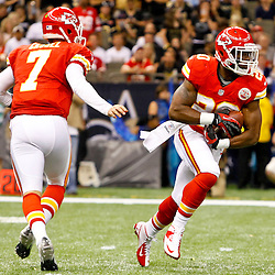 September 23, 2012; New Orleans, LA, USA; Kansas City Chiefs quarterback Matt Cassel (7) hands off to running back Shaun Draughn (20) during the second quarter of a game against the New Orleans Saints at the Mercedes-Benz Superdome. Mandatory Credit: Derick E. Hingle-US PRESSWIRE