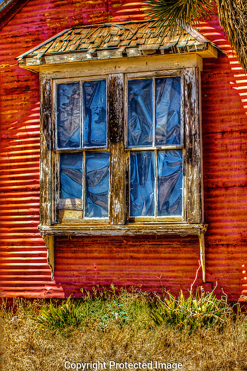 This window gives a glimpse of the mining era's past in quint and quirky Chloride, Arizona