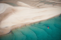 Flying over the lagoons off the coast of Mozambique on my non-motorized paragliding, sailing with pink flamingoes and silence, this was one of the most beautiful and surreal places I've ever been.