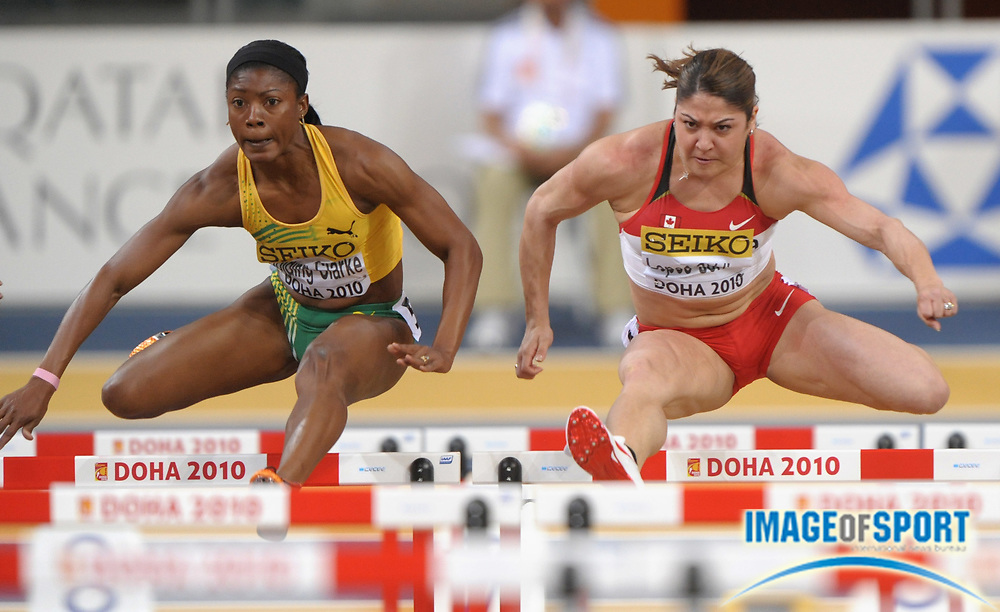Mar 12, 2010; Doha, QATAR; Priscilla Lopes-Schiliep (CAN), right, and Lacena Golding-Clarke (JAM) finished first and second in a women's 60m hurdle heat in  7.94 and 8.02 in the IAAF World Indoor Championships in Athletics at the Aspire Dome.