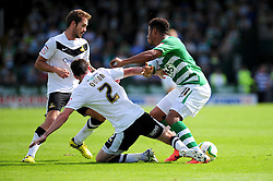 Yeovil Town's Reuben Reid is challenged by Doncaster Rovers' Paul Quinn - Photo mandatory by-line: Dougie Allward/Josephmeredith.com  - Tel: Mobile:07966 386802 01/09/2012 - SPORT - FOOTBALL - League 1 -  Yeovil  - Huish Park -  Yeovil Town v Doncaster Rovers
